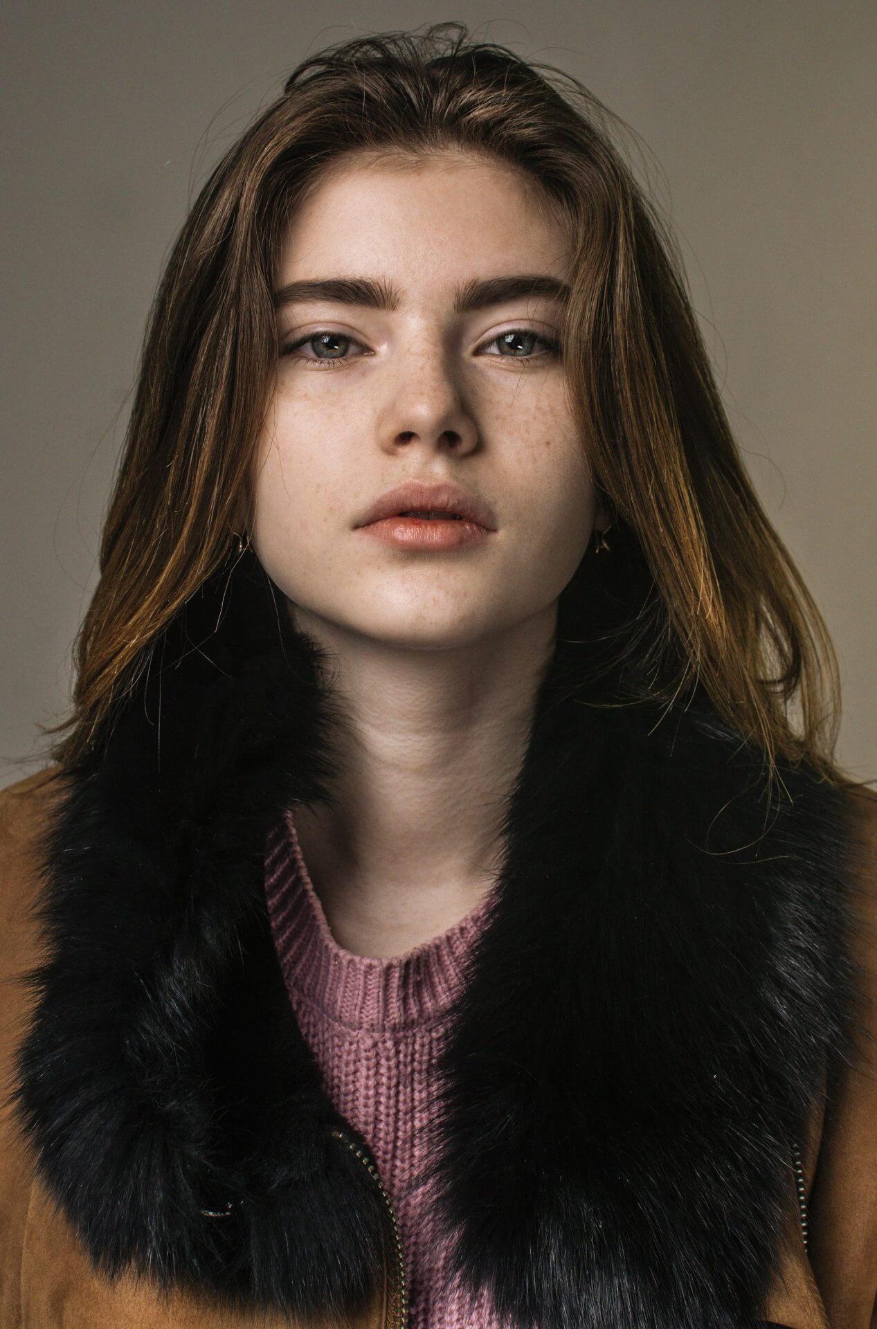 Portrait of a woman wearing fur jacket